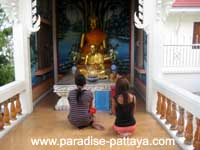 in front of Buddha Statue Prayer