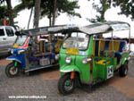 tuk tuks parked at the beach